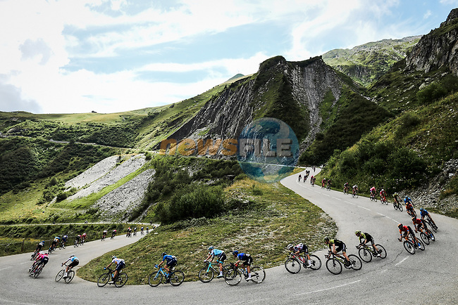 The peloton descends Col de la Madeleine during Stage 3 of Criterium du Dauphine 2020, running 157km from Corenc to Saint-Martin-de-Belleville, France. 14th August 2020.<br /> Picture: ASO/Alex Broadway | Cyclefile<br /> All photos usage must carry mandatory copyright credit (© Cyclefile | ASO/Alex Broadway)