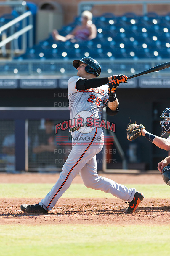 Glendale Desert Dogs catcher Martin Cervenka (25), of the Baltimore Orioles organization, follows through on his swing during an Arizona Fall League game against the Peoria Javelinas at Peoria Sports Complex on October 22, 2018 in Peoria, Arizona. Glendale defeated Peoria 6-2. (Zachary Lucy/Four Seam Images)