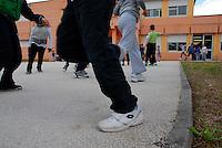 Brescia / Italia giugno 2013<br /> Piattaforma di cemento costruita nel giardino della Scuola Elementare Deledda di Brescia per consentire agli alunni di  giocare all'aperto durante l'intervallo. E' proibito giocare sull'erba a causa della contaminazione da PCB.<br /> Foto Livio Senigalliesi