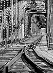 An old bridge goes over old railroad tracks in Atchison, Kansas.