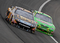 Feb 22, 2009; Fontana, CA, USA; NASCAR Sprint Cup Series driver David Ragan (6) races alongside Kyle Busch during the Auto Club 500 at Auto Club Speedway. Mandatory Credit: Mark J. Rebilas-