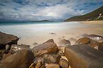 Misty water over the rocks at Zenith Beach, Shoal Bay, Port Stephens, NSW, Australia