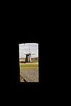 Dutch windmills in the landscape.