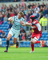 Toby Flood of Leicester Tigers is tackled by Lee Beach of London Welsh during the Aviva Premiership match between London Welsh and Leicester Tigers at the Kassam Stadium on Sunday 2nd September 2012 (Photo by Rob Munro)