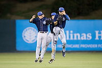 (L-R) Asheville Tourists outfielders Eric Toole (14), Cole Anderson (16), and Willie Abreu (6) celebrate their win over the Kannapolis Intimidators at Kannapolis Intimidators Stadium on May 5, 2017 in Kannapolis, North Carolina.  The Tourists defeated the Intimidators 5-1.  (Brian Westerholt/Four Seam Images)
