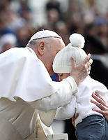 Papa Francesco bacia un bambino al suo arrivo all'udienza generale del mercoledi' in Piazza San Pietro, Citta' del Vaticano, 20 marzo 2019.<br /> Pope Francis kisses a child as he arrives to lead his weekly general audience in St. Peter's Square at the Vatican, on March 20, 2019.<br /> UPDATE IMAGES PRESS/Isabella Bonotto<br /> <br /> STRICTLY ONLY FOR EDITORIAL USE