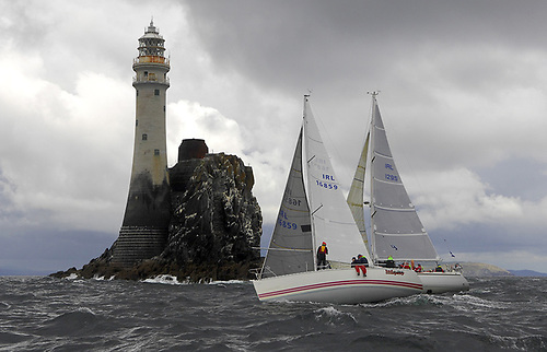 Rounding the Fastnet Rock at Calves Week Regatta - Class Two yachts, the Dehler 36 Lisador IRL1295 (Henry Hogg) of Garrykennedy Sailing Club and Frank Desmond's Sunfast 32 Bad Company from Royal Cork Yacht Club