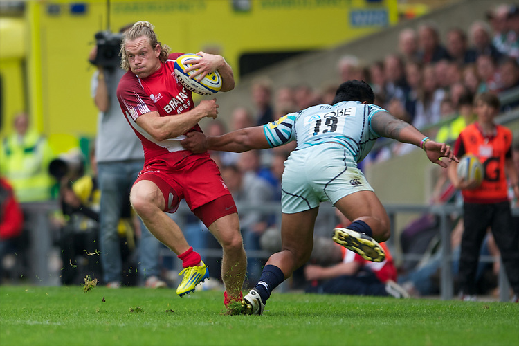 Phil MacKenzie of London Welsh hands off Manusamoa Tuilagi of Leicester Tigers during the Aviva Premiership match between London Welsh and Leicester Tigers at the Kassam Stadium on Sunday 2nd September 2012 (Photo by Rob Munro)