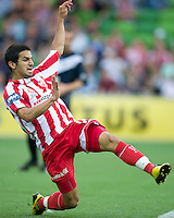 MELBOURNE, AUSTRALIA - DECEMBER 11: Aziz Behich of the Heart reaches for the ball during the round 18 A-League match between the Melbourne Heart and Melbourne Victory at AAMI Park on December 11, 2010 in Melbourne, Australia. (Photo by Sydney Low / Asterisk Images)
