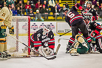 17 December 2013:  Northeastern University Huskies Goaltender Clay Witt, a Redshirt Junior from Brandon, FL, makes a second period save against the University of Vermont Catamounts at Gutterson Fieldhouse in Burlington, Vermont. Witt recorded a shut out as the Huskies defeated the Catamounts 3-0 to end UVM's 5 game winning streak. Mandatory Credit: Ed Wolfstein Photo *** RAW (NEF) Image File Available ***