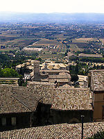 Umbria, Assisi, Italy, view from city wall over valley with San Maria Maggiore church in middle distanc