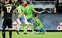 LOS ANGELES, CA - OCTOBER 29: Nicolas Lodeiro #10 of the Seattle Sounders FC scores a goal with a sliding  celebration during a game between Seattle Sounders FC and Los Angeles FC at Banc of California Stadium on October 29, 2019 in Los Angeles, California.
