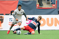 FOXBOROUGH, MA - APRIL 17: Justin Rennicks #12 of New England Revolution II plays the ball from the ground near the New England goal during a game between Richmond Kickers and Revolution II at Gillette Stadium on April 17, 2021 in Foxborough, Massachusetts.