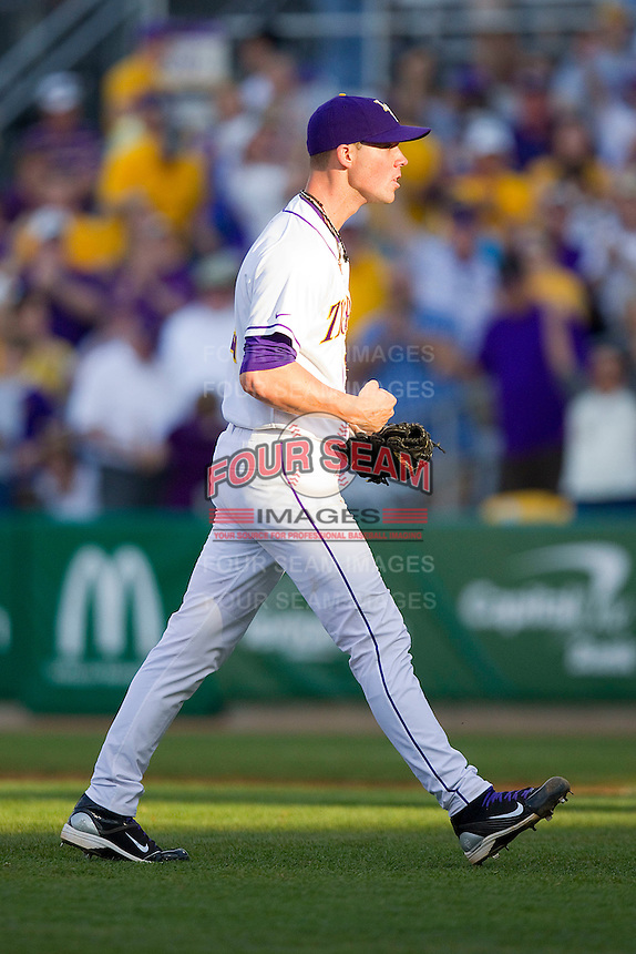 Closer Matt Ott #22 of the LSU Tigers reacts after getting the final out against the Wake Forest Demon Deacons at Alex Box Stadium on February 19, 2011 in Baton Rouge, Louisiana.  The Tigers defeated the Demon Deacons 4-3.  Photo by Brian Westerholt / Four Seam Images