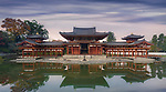 Beautiful Amida Hall of Byodoin Japanese Buddhist temple reflecting in the water of Jodoshiki Pure Land garden pond in a peaceful autumn morning scenery. Byodo-in, Uji, Kyoto Prefecture, Japan 2017 Image © MaximImages, License at https://www.maximimages.com