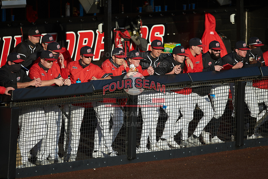 The Western Kentucky Hilltoppers bench watches from the dugout during the game against the Valparaiso Crusaders at Nick Denes Field on March 19, 2021 in Bowling Green, Kentucky. (Brian Westerholt/Four Seam Images)