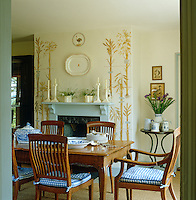 Glimpse into the dining room with the wall around the fireplace painted by Mary MacCarthy