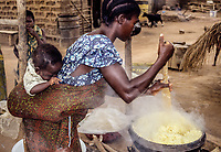 Bamoro, Cote d'Ivoire (Ivory Coast).  Village Woman Preparing Atieke, a Starchy Staple Made from Cassava.