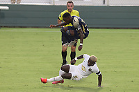 CARY, NC - AUGUST 01: Akeem Ward #30 jumps over Anderson Asiedu #6 during a game between Birmingham Legion FC and North Carolina FC at Sahlen's Stadium at WakeMed Soccer Park on August 01, 2020 in Cary, North Carolina.