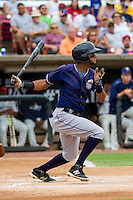 Lake County Captains shortstop Willi Castro (6) at bat during a Midwest League game against the Wisconsin Timber Rattlers on July 24, 2016 at Fox Cities Stadium in Appleton, Wisconsin. Lake County defeated Wisconsin 6-2. (Brad Krause/Four Seam Images)