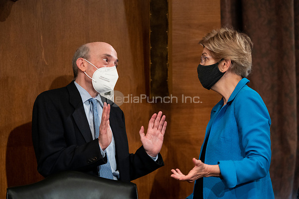 """United States Senator Elizabeth Warren (Democrat of Massachusetts), speaks with Gary Gensler,<br /> Chair of the U.S. Securities and Exchange Commission, before the start of the Senate Banking, Housing, and Urban Affairs Committee hearing on """"Oversight of the U.S. Securities and Exchange Commission"""" on Tuesday, Sept. 14, 2021.<br /> Credit: Bill Clark / Pool via CNP /MediaPunch"""