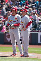 Stephen Piscotty (22) and Mark Budaska (34) of the Memphis Redbirds in action against the Omaha Storm Chasers in Pacific Coast League action at Werner Park on April 22, 2015 in Papillion, Nebraska.  (Stephen Smith/Four Seam Images)