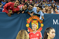 Houston, TX - Thursday July 20, 2017: Fans pose with Bianca Henniger, former Goalkeeper for the Houston Dash during a match between Manchester United and Manchester City in the 2017 International Champions Cup at NRG Stadium.