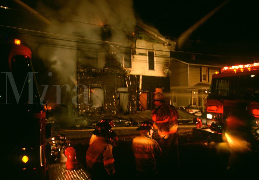 Firefighters battle a house fire.