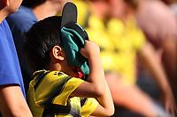 11th September 2021; Vicarge Road, Watford, Herts,  England;  Premier League football, Watford versus Wolverhampton Wanderers; A Watford fan hides behind his cap as his team go 0-2 down