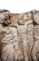 Detail of a Roman Sebasteion relief sculpture of Zeus and Prometheus, Aphrodisias Museum, Aphrodisias, Turkey.      Against a white background.<br /> <br /> Prometheus is screaming in pain. Zeus had given him a terrible punishment for giving fire to man: he was tied to the Caucasus mountains and had his liver picked out daily by an eagle. Herakles shot the eagle and is undoing the first manacle. He wears his trade mark lion-skin and thrown his club to one side. A small mountain nymph, holding a throwing stick appears amongst the rocks.