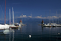 Switzerland, La Cote, Vaud, Lake Geneva, Boats docked in the harbor along the lakefront in the town of Morges on Lac Leman.
