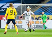 SOLNA, SWEDEN - APRIL 10: Julie Ertz #8 of the USWNT dribbles during a game between Sweden and USWNT at Friends Arena on April 10, 2021 in Solna, Sweden.