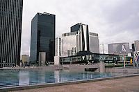 Paris: La Defense, 1987. Looking southwest from center: The Y-shaped building surmounting entertainment complex is the SCOR Centre Commercial Les Quatre Temps Elysees; left, black towers of Credit Lyonnais & Atlantique. Photo '87.