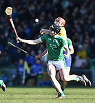 Peter Duggan of  Clare  in action against Declan Hannon of  Limerick during their NHL quarter final at the Gaelic Grounds. Photograph by John Kelly.
