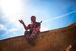 © Joel Goodman - 07973 332324. 30/07/2017 . Manchester , UK . Deadpool (Wayne Parker) outside the venue . Cosplayers, families and guests at Comic Con at the Manchester Central Convention Centre . Photo credit : Joel Goodman