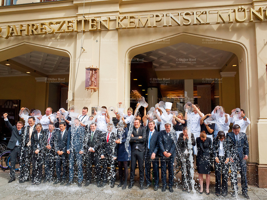 Germany. Bavaria state. Munich. Ice Bucket Challenge for the direction and stafff of the 5 star luxurious Hotel Vier Jahreszeiten Kempinski on Maximilianstrasse 17. Ice Bucket Challenge, sometimes called the ALS Ice Bucket Challenge, is an activity involving dumping a bucket of ice water on someone's head to promote awareness of the disease amyotrophic lateral sclerosis (ALS) and encourage donations to research. It went viral on social media during July–August 2014. The challenge encourages nominated participants to be filmed having a bucket of ice water poured on their heads and then nominating others to do the same. A common stipulation is that nominated participants have 24 hours to comply or forfeit by way of a charitable financial donation. Munich is the capital and largest city of the German state of Bavaria. 26.08.2014 © 2014 Didier Ruef