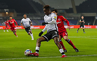 30th December 2020; Liberty Stadium, Swansea, Glamorgan, Wales; English Football League Championship Football, Swansea City versus Reading; Jamal Lowe of Swansea City controls the ball while under pressure from Tom McIntyre of Reading FC