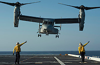 130423-N-DR144-600 Pacific Ocean (April 23, 2013)-  Aviation Boatswain's Mates (Handling) direct an MV-22 Osprey assigned to Marine Medium Tiltrotor Squadron (VMM) 161 as it launches from the flight deck of the Amphibious Transport Dock Ship USS Anchorage (LPD 23). Anchorage is currently en route to its namesake city of Anchorage, Alaska for its commissioning ceremony May 4. (U.S. Navy photo by Mass Communication Specialist 1st Class James R. Evans / RELEASED)