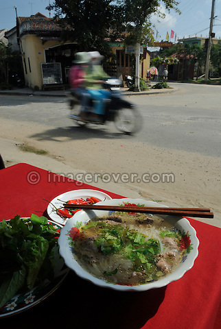 Asia, Vietnam, Hoi An. Hoi An. Pho Bo. Traditional noodle soup with a slice of beef served as delicious street food. The historic buildings, attractive tube houses, and decorated community halls have 1999 earned Hoi An's old quarter the status of a UNESCO World Heritage Site. To protect the old quarter's character stringent conversation laws prohibit alterations to buildings, as well as the presence of cars on the roads.