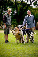 33 year old Howard and 72 year old Neil, white farmers living near Bulawayo, pictured with their dogs.