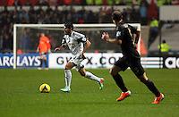 Wednesday, 01 January 2014<br /> Pictured: Alejandro Pozuelo (L).<br /> Re: Barclay's Premier League, Swansea City FC v Manchester City at the Liberty Stadium, south Wales.