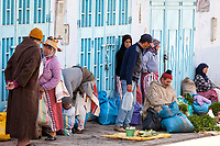 Chefchaouen, Morocco.  Street Vendors Opposite Local Bus Stop.