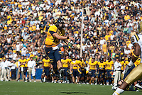 Kevin Riley throws the ball midair. The California Golden Bears defeated the UCLA Bruins 35-7 at Memorial Stadium in Berkeley, California on October 9th, 2010.