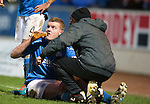 St Johnstone v Partick Thistle....17.01.15  SPFL<br /> Brian Easton receives treatment for cramp<br /> Picture by Graeme Hart.<br /> Copyright Perthshire Picture Agency<br /> Tel: 01738 623350  Mobile: 07990 594431