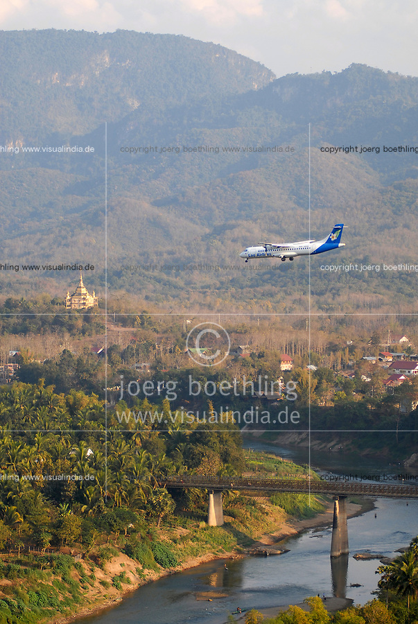 LAO PDR, Luang Prabang,<br /> view from Stupa That Chomsi to river Nam Khan , landing aeroplane of Lao Airlines