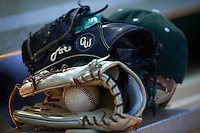 Dartmouth Big Green hat, fielding gloves, and baseball sit on the dugout bench during a game against the Eastern Michigan Eagles on February 25, 2017 at North Charlotte Regional Park in Port Charlotte, Florida.  Dartmouth defeated Eastern Michigan 8-4.  (Mike Janes/Four Seam Images)