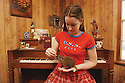 """Becky Verret, 17, plays with her three-week-old nutria """"Shaggy,'' 2002"""