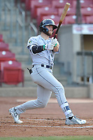 Cedar Rapids Kernels left fielder Trey Cabbage (25) swings at a pitch against the Quad Cities River Bandits at Veterans Memorial Stadium on April 16, 2019 in Cedar Rapids, Iowa.  The Kernels won 11-2.  (Dennis Hubbard/Four Seam Images)