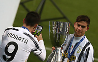 Football: Super Cup Final Juventus vs Napoli at Mapei Stadium in Reggio Emilia, on January 20,  2021.<br /> Juventus' Alvaro Morata (l) and Paulo Dybala (r) celebrate with the trophy after winning 2-0  the Italian Super Cup Final match between Juventus and Napoli at Mapei Stadium in Reggio Emilia, on January 20,  2021.<br /> UPDATE IMAGES PRESS/Isabella Bonotto