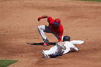 Philadelphia Phillies shortstop C.J. Chatham (30) tags Austin Hays (21) out while attempting to steal second base during a Major League Spring Training game against the Baltimore Orioles on March 12, 2021 at the Ed Smith Stadium in Sarasota, Florida.  (Mike Janes/Four Seam Images)